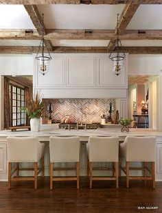 love the brick herringbone backsplash and the lights