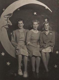 Three Girls Sitting on 'Moon Seat', Photo Studio, Luna Park, St Kilda, circa 1943