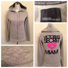 """Victoria Secrets Models Essentials Miami Hoodie XS Nice Victoria's Secret Grey Hoodie. Size XS runs true to size. It's similar to a size 2/4. Two light spots pictured. Other few fuzzies in cuffs. No fuzzies under arms. The angel wings are light. Loosing some sparkle. Arm pit to arm pit measures 18 inches. Sleeve length 27"""" inches. Very long sleeves. From back of neck to hem is 22"""" inches. Victoria's Secret Tops Sweatshirts & Hoodies"""