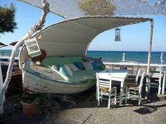 An old boat transformed into a terrace couch. Quelle Luxe !!