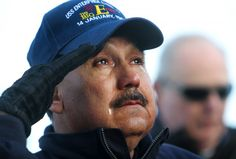 """Jimmy Gonzales struggles to hold back tears during a ceremony on Friday, Nov. 30, 2012, to honor those who were killed in the Jan. 14, 1969, fire on the flight deck of the USS Enterprise. Gonzales, who lives near Dallas, set foot on the """"Big E"""" for the first time since he was an 18-year-old seaman apprentice who helped care for the wounded and dying. """"I hadn't even made it to Vietnam yet,"""" Gonzales remembers, """"and I had already seen more than"""
