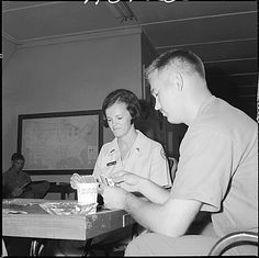 Loretta Clause plays cards, talks, etc. with Marines. She is a volunteer worker for the Red Cross, August 2, 1967.