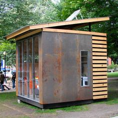 love the combo of metal and wood and angled roof. 10×10 Microhouse...... A 100 square feet microhouse designed by Northern Timbers Construction.