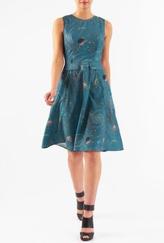 Faux-flap pockets detail the front of our constellation print crepe dress styled with front metal zip pockets at the flared skirt.
