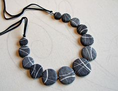 Beach stones necklace, collection Rocks made of Papier Mache. A unique and original line of jewelry inspired by the beauty of the stones as well as nature designed them. by Sognoametista