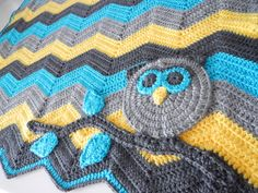 Lovely owl/ripple blanket - No specific pattern but description is given on how to make the owl and branch, as well as blanket. Not for a beginner, but good if you're experienced and can figure it out on your own.