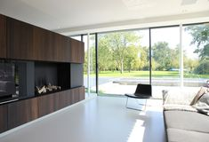 Built by grassodenridder_architecten in Goes, The Netherlands The design for this large family house refers to the Dutch typology of the 'long-house'. Although this typology has b. Interior Exterior, Interior Architecture, Interior Design, Long House, Custom Fireplace, Fireplace Ideas, Minimalist Architecture, Living Room Tv, New Homes