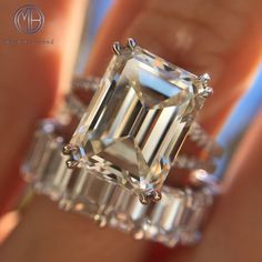 This astonishing emerald cut diamond engagement ring will mesmerize you with its magnificent size, quality, and beauty! The 4.77ct emerald cut diamond poised in the center is GIA certified at L-VS1. It has a warmer white color and it is perfectly clear, even under 10X magnification. The cut and shape of the diamond is breathtaking!