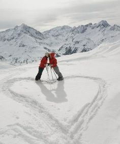 Heart in the snow.  Love the all white with red jackets.  expensivelife™