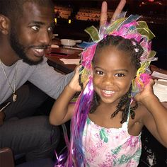 Basketball player and his daughter pose for a cute father-daughter photo. | essence.com
