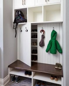 Our creative mudroom design features hidden shoe storage cabinets behind panelle. - Our creative mudroom design features hidden shoe storage cabinets behind panelled doors dressed wit - Entryway Shoe Storage, Diy Shoe Storage, Entryway Closet, Storage Hacks, Shoe Cubby, Hidden Storage, Closet Doors, Closet Mudroom, Coat And Shoe Storage