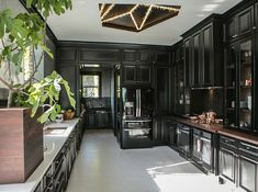 House Beautiful Kitchen of the Year 2014. Do not like! WTF is that light fixture, a pentagram?