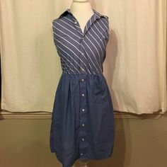 Vintage shirt dress size 4/small Vintage shirt dress size 2/4 small. Cinched waist, single hip pocket, men's shirt collar style. Hits just below knee Vintage Dresses Midi