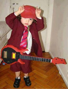 bd0ad1f183 a mini Angus from AC DC. This will be my kid on Halloween! m  Rock on  little man