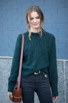 black high-waisted jeans + forest green sweater