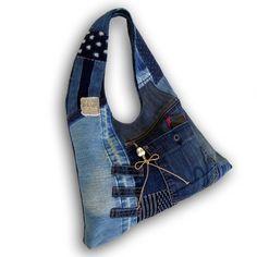 一点もの。古着ジーンズと藍染め絣の古布と手染め藍染めデニムの大きめなリメイクHOBOバッグです。 カジュアルファッションにお勧めです。バッグの内側は、着物地の...|ハンドメイド、手作り、手仕事品の通販・販売・購入ならCreema。