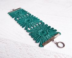 This is so pretty! Etsy listing at https://www.etsy.com/listing/196426295/emerald-lace-cuff-soleil-in-metallic