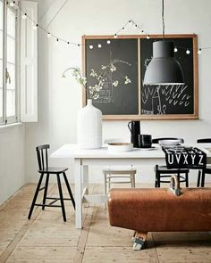 Love the pendant lamp and the gym horse adds a great twist to this dinning space