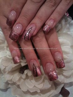 Pink glitter tips with nail art. Love the design! Prefer shorter nails though.