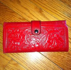 Red tooled mexican leather wallet.