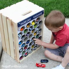 Toy Car park with pvc tubes and wooden crate storage idea Hot Wheels Storage, Toy Car Storage, Crate Storage, Storage Ideas, Toy Storage Solutions, Matchbox Car Storage, Hot Wheels Display, Vinyl Storage, Diy Wooden Crate
