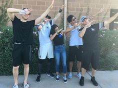 No one in this picture knows how to dab (not that I do) also Luke's wearing slides lol