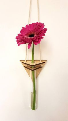 Geo floral wall hanger - Triangle Laser cut wood wall hanger, with glass vase holder. Vase holder is glass test tube with rim. Hanging length - W 8.5cm x L 45cm approx Flower not provided Standard delivery is 2nd class post