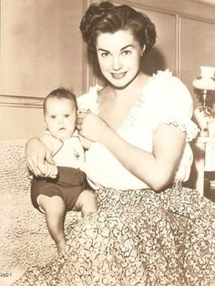 """Benjamin Stanton Gage faces the cameras for the first time with his Mother, Esther Williams.""  May 18th, 1950"