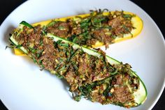 Stuffed Zucchini- looks tooo healthy, but with a plethora of zucchini, in desperation, trying this!
