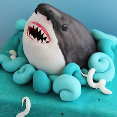 shark cake tutorial - Google Search - Small shark round cake as top tier, and then cupcakes with shark fins, and divers!!! Louis will flip!