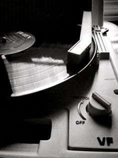 The way we used to listen to music (well, some of us still do). Vinyl record on the turntable.