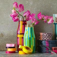 Washi tape vases  (The best way we can describe washi tape is that it feels like masking tape — very, very pretty masking tape...http://www.sheknows.com/living/articles/951617/what-is-washi-tape)