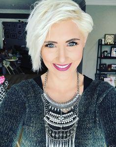 Platinum pixie hair cut.