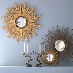 Sunburst mirrors and gray blue walls