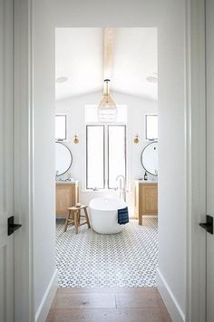 We're sharing beautiful bathrooms today that all pair warm wood vanities in golden tones with crisp white walls and marble. You're going to love the look. Bathroom Spa, Bathroom Interior, Bathroom Goals, Bathroom Hacks, Bathroom Plants, Bathroom Closet, Bathroom Modern, Remodel Bathroom, Basement Bathroom