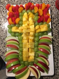 Easter Cross Fruit tray. Super easy to make. DIY Only half a pineapple, 2 apples, 8oz strawberries, 8oz grapes, and 8oz mandarin oranges. Wash all the fruit, cut and assemble. You will want to soak the apples in lime juice for a few minutes after cutting. Serve with a fruit dip.