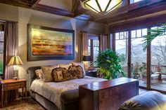 Plush fabrics, exotic woods, and exposed ceiling beams bring this luxurious room together. Muted, rich colors and satin bed coverings bring a level of class to this relaxing bedroom. Modern Rustic Bedrooms, Rustic Bedroom Design, Rustic Home Design, Master Bedroom Design, Bedroom Decor, Bedroom Ideas, Master Bedrooms, Bedroom Designs, Modern Farmhouse