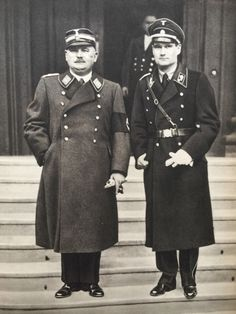 Ernst Röhm & Rudolf Hess. The thug (on the left) and the borderline moron. The thug was murdered by Hitler. The moron flew to Scotland. Go figure.