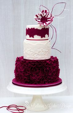 Burgundy and White Ruffle cake with lace and candy stripe flower