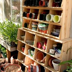 Nursery pots and planting paraphernalia stay put in these cleverly constructed garden shelves.