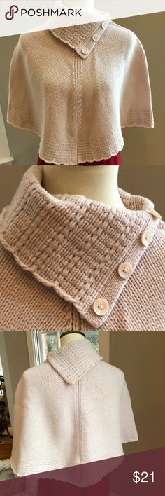 Gap Light Pink Cape 100% Lambswool Adorable Gap S/M light pink cape with buttons at the neck. 100% lambswool. I wore it with a animal print pencil skirt. Width at neck is 9 1/2 inches. Neck to bottom length is 17 inches and shoulder to bottom is 14 inches. Please see pictures. GAP Sweaters Shrugs & Ponchos