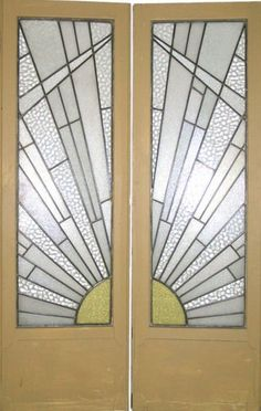 art deco stained glass french doors in typical sunburst pattern