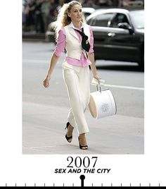Sarah Jessica Parker as Carrie Bradshaw puts her own spin on the masculine-feminine look with a white tuxedo vest and matching tailored trousers.