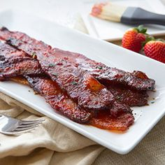 Breakfast bacon gets a spicy twist! Thick slices of peppery bacon are topped with spicy Sriracha and sweet honey, then baked until curly and golden. This delicious recipe pairs beautifully with any breakfast favorite. It makes a fun addition to brunch menus, as well!