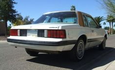 White 1979 Mustang Ghia optioned coupe, rear right view with vinyl roof and matching pin striping. 1979 Mustang, Fox Body Mustang, Mercury Capri, Mustangs, Classic Cars, Automobile, Wheels, Ford, Cars
