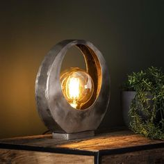 This industrial table lamp has a single light source and is made of metal and is finished in old silver. The light sources distributes the light in a beautiful way through the room, creating a great ambiance. Industrial Floor Lamps, Industrial Ceiling Lights, Rustic Industrial Decor, Drop Lights, Hanging Lights, Metal Lattice, Lampe Decoration, Luz Led, Light Fittings