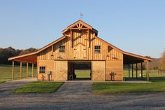 The Teton 72 - Barn Pros. Surely I can tart up a colorbond one to resemble this type of thing.....with timber posts, doors, verandahs, lighting and landscaping. It work shed.......