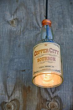 Arizona Copper City Pendant Light Shade makes for great industrial lighting!  Bourbon bottle lights and bottle lamps are trendy and fun! Get yours by CLICKING on the picture to go to my Etsy shop www.etsy.com/shop
