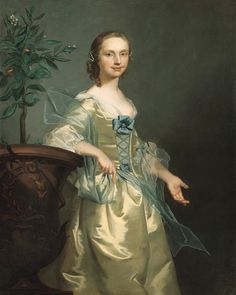 1751 Lady, said to be Isabella Courtenay, Mrs. Andrews standing three-quarter length, wearing a yellow satin dress with a blue bow and wrap, beside an orange tree by Thomas Hudson
