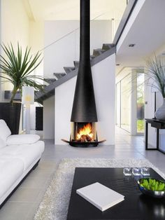 Modern Fireplace That Inspire You To Create Yours Design Inspiration Inviting a fireplace in your living space can be a great idea. It can warp up your room during a cold season. A fireplace should be cozy, thus you sho. Fireplace Update, Black Fireplace, Open Fireplace, Living Room With Fireplace, Cozy Living Rooms, Fireplace Ideas, Suspended Fireplace, Fireplace Pictures, Tile Fireplace
